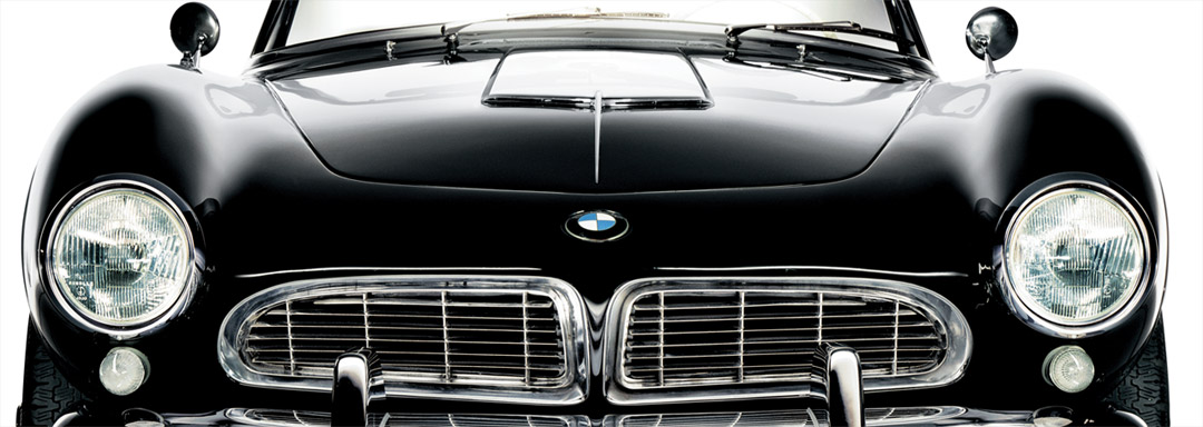 BMW Certified Classic Centers. Close-up of the front end of a classic black BMW 507 photographed in-studio on a white background.